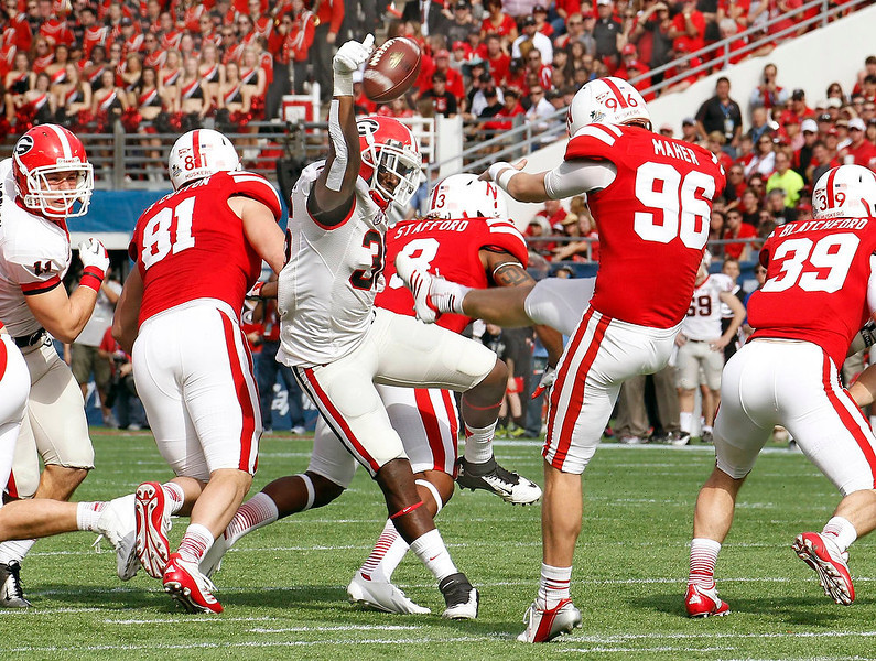 . Georgia Bulldogs safety Shawn Williams (36) blocks the punt of  Nebraska Cornhuskers kicker Brett Maher (96) during the Capital One Bowl in Orlando, Florida January 1, 2013. REUTERS/Pierre DuCharme