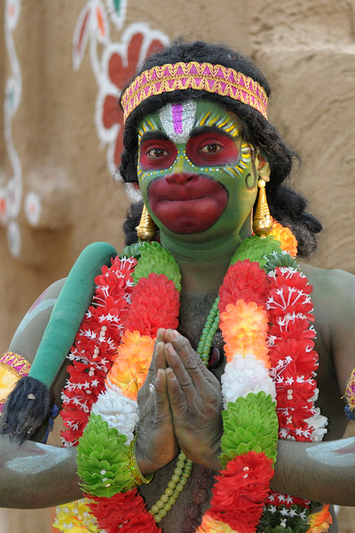 Dressed as a monkey and doing the part of Hanuman, this tribal dance performers was from Andra Pradesh. Painted face and behaving like a monkey he jumped and roamed around the Surajkund Crafts Mela 2009, Haryana, North India.