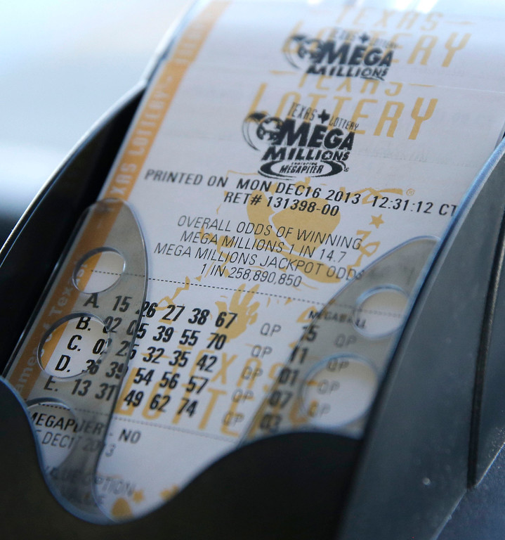 . Mega Millions lottery tickets are printed out at the Fuel City convenience story Monday, Dec. 16, 2013, in Dallas. The Mega Millions jackpot soared to $586 million on Monday amid a frenzy of ticket purchases, a jump that pushed the prize closer to the $656 million U.S. record set last year. (AP Photo/LM Otero)