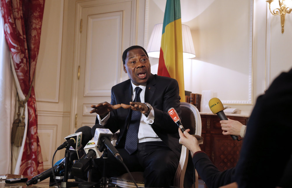 Description of . Benin's President Thomas Boni Yayi talks during an interview on February 7, 2013 in Paris, as part of a State visit to France. Boni Yayi called for France's continued
