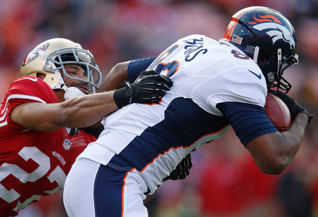 . The San Francisco 49ers\' C.J. Spillman (27) tackles the Denver Broncos\' Julius Thomas in the second quarter in preseason action at Candlestick Park in San Francisco, California, on Thursday, August 8, 2013. The Broncos won, 10-6. (Nhat V. Meyer/Bay Area News Group)