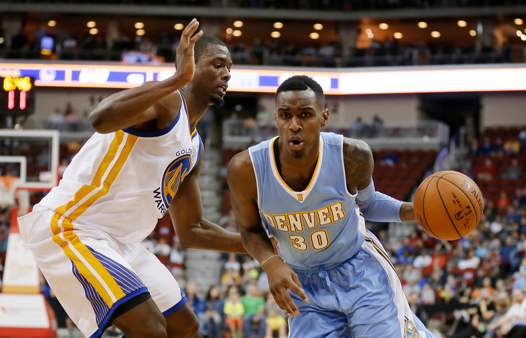 . Denver Nuggets forward Quincy Miller, right, drives past Golden State Warriors forward Harrison Barnes during the second half of a preseason NBA basketball game, Thursday, Oct. 16, 2014, in Des Moines, Iowa. Golden State won 104-101. (AP Photo/Charlie Neibergall)