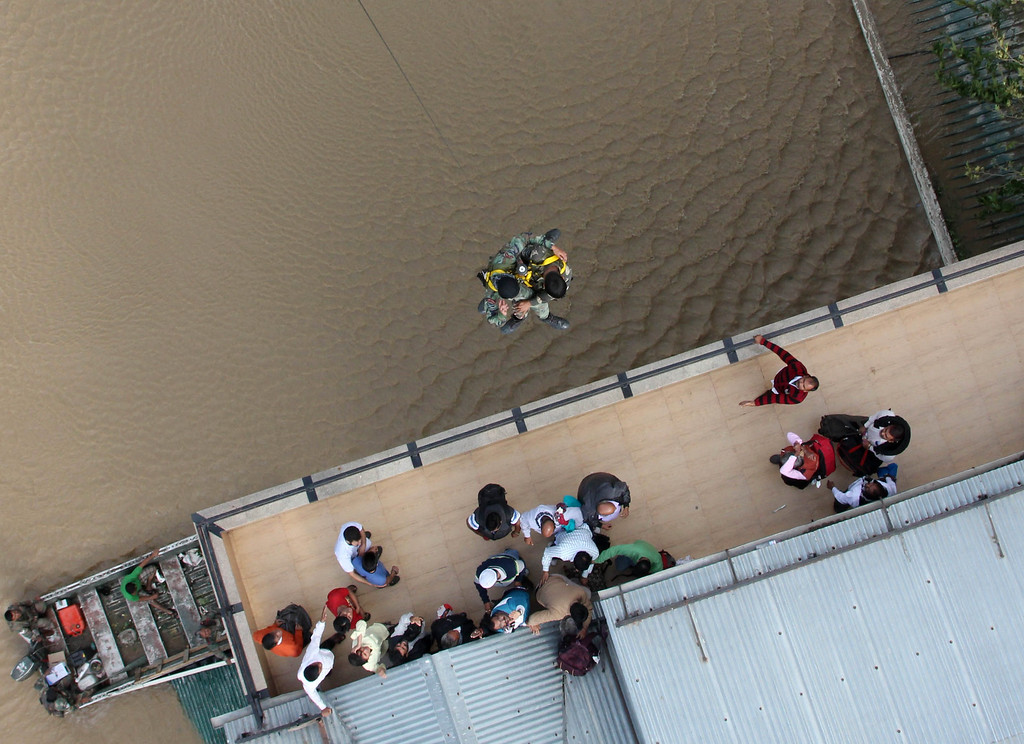 . In this handout photograph released by Indian Ministry of Defense on September 10, 2014, Indian Air Force personnel use a winch to reach residents stranded on a rooftop during rescue and relief efforts following flooding Srinagar. AFP PHOTO/MINISTRY OF DEFENCE/AFP/Getty Images
