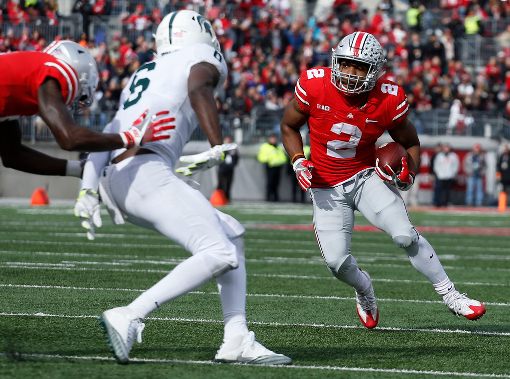 . Ohio State running back J.K. Dobbins cuts up field to score a touchdown against Michigan State during the first half of an NCAA college football game Saturday, Nov. 11, 2017, in Columbus, Ohio. (AP Photo/Jay LaPrete)
