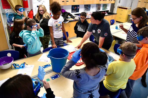 10/3/2019 Mike Orazzi | Staff Lindsey Rivers and Sarah Larson explain how to make natural cleaners from vinegar, rosemary and lemons to 6th grade students at the Greene-Hills School in Bristol on Thursday morning.