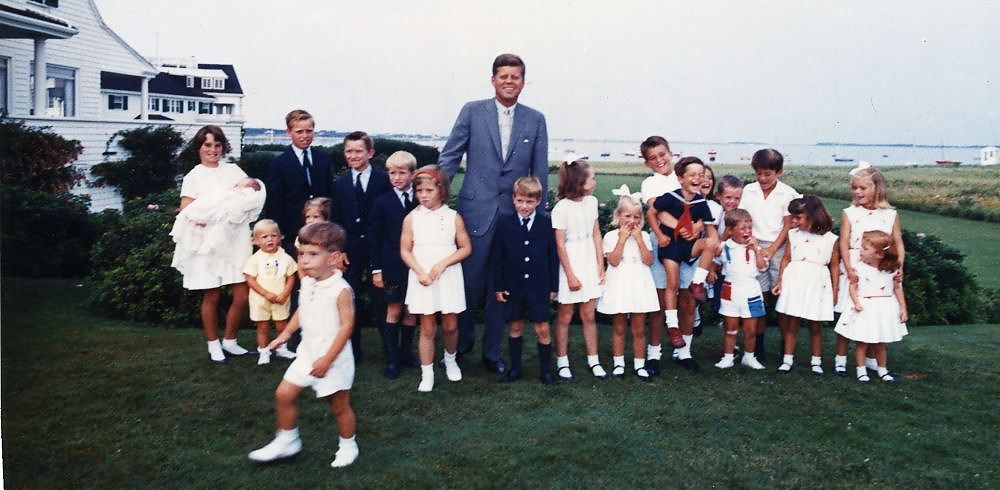 Description of . Kennedy poses with members of the younger generation of Kennedys in Hyannis, Mass. on Aug. 3, 1963. John F. Kennedy Presidential Library and Museum