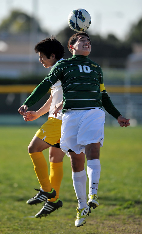 . 2/13/13 - L-R Andrew Alonso of Kennedy High School battles for the ball against  Byron Rivers of Narbonne during the L.A. City Section Division I playoffs. Narbonne won 1-0. Photo by Brittany Murray / Staff Photographer