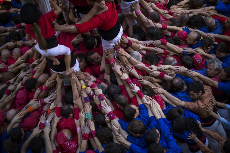 """. Members of the Castellers \""""Vila de Gracia\"""" form their famous human tower called \""""castell\"""" in the Barcelona neighborhood of Gracia, Catalonia, Spain on Sunday May 19 2013. A \""""castell\"""" is a human tower traditionally built during festivals in many places in Catalonia. At these festivals, several \""""colles\"""" or teams compete to build the most impressive towers they can. (AP Photo/Emilio Morenatti)"""