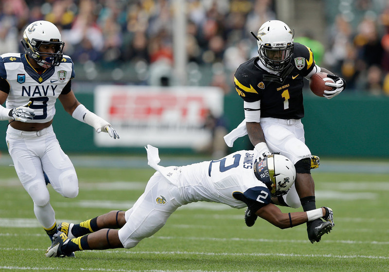 . Marion Grice #1 of the Arizona State Sun Devils is tackled by Parrish Gaines #2 of the Navy Midshipmen during the Kraft Fight Hunger Bowl at AT&T Park on December 29, 2012 in San Francisco, California.  (Photo by Ezra Shaw/Getty Images)