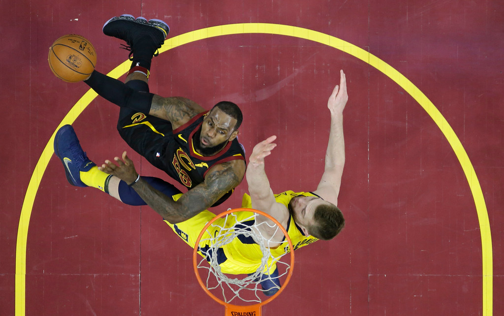 . Cleveland Cavaliers\' LeBron James, left, drives to the basket against Indiana Pacers\' Domantas Sabonis, from Lithuania, in the first half of Game 5 of an NBA basketball first-round playoff series, Wednesday, April 25, 2018, in Cleveland. The Cavaliers won 98-95. (AP Photo/Tony Dejak)