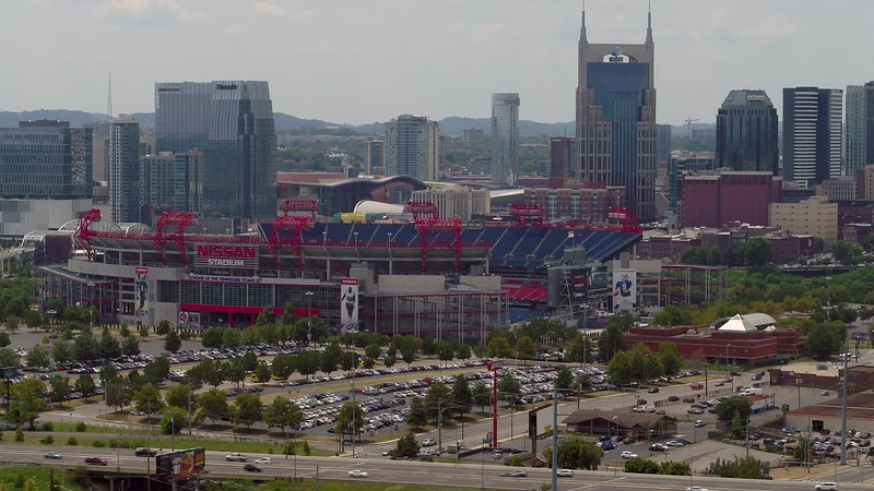 Epic aerial drone video Nissan Stadium with downtown Nashville background 4k 24p