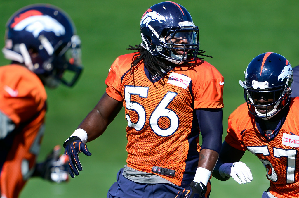 . Nate Irving (56) works through drills with fellow linebackers. The Denver Broncos football team gets in their final day of practice during training camp at Dove Valley  on Friday, Aug. 15, 2014. (Photo by Kathryn Scott Osler/The Denver Post)