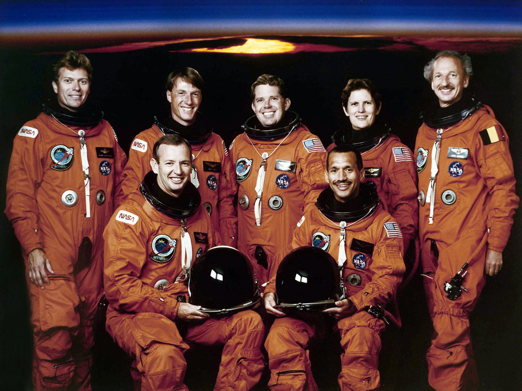 . Photo shows seven crewmembers for NASA?s STS-45 mission in January 1992, are pictured in their partial-pressure launch and entry suits. In front are astronauts Charles F. Bolden, Jr. (right), mission commander, and Brian Duffy, pilot. Back row, left to right, are payload specialist Byron K. Lichtenberg; astronauts C. Michael Foale and David C. Leestma, mission specialists; astronaut Kathryn D. Sullivan, payload commander, and payload specialist Dirk Frimout of Belgium. The Atmospheric Laboratory for Applications and Science (ATLAS) is scheduled for a March 1992 launch aboard the Atlantis. (AP Photo)