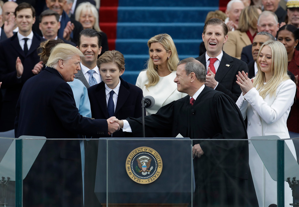. Donald Trump shakes hands with Chief Justice John Roberts after being sworn in as the 45th president of the United States on during the 58th Presidential Inauguration at the U.S. Capitol in Washington, Friday, Jan. 20, 2017. (AP Photo/Patrick Semansky)