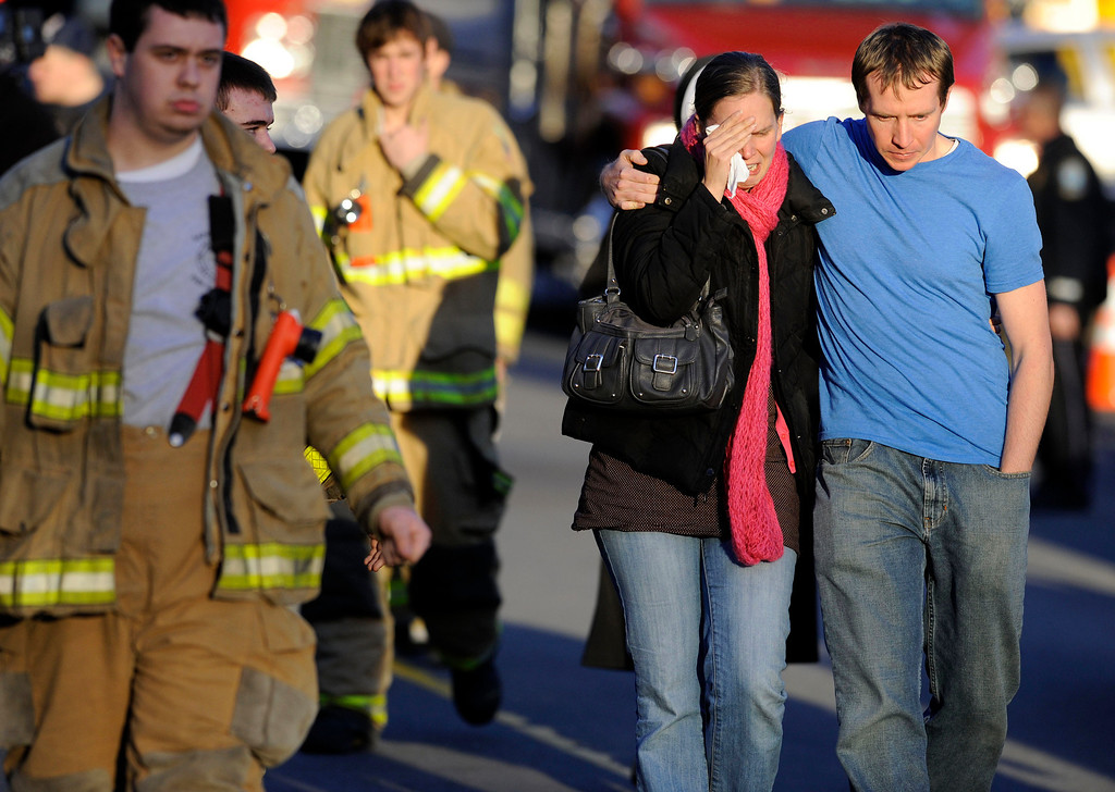 . Victims family leave a firehouse staging area following a shooting at the Sandy Hook Elementary School in Newtown, Conn., about 60 miles (96 kilometers) northeast of New York City, Friday, Dec. 14, 2012. An official with knowledge of Friday\'s shooting said 27 people were dead, including 18 children.  (AP Photo/Jessica Hill)