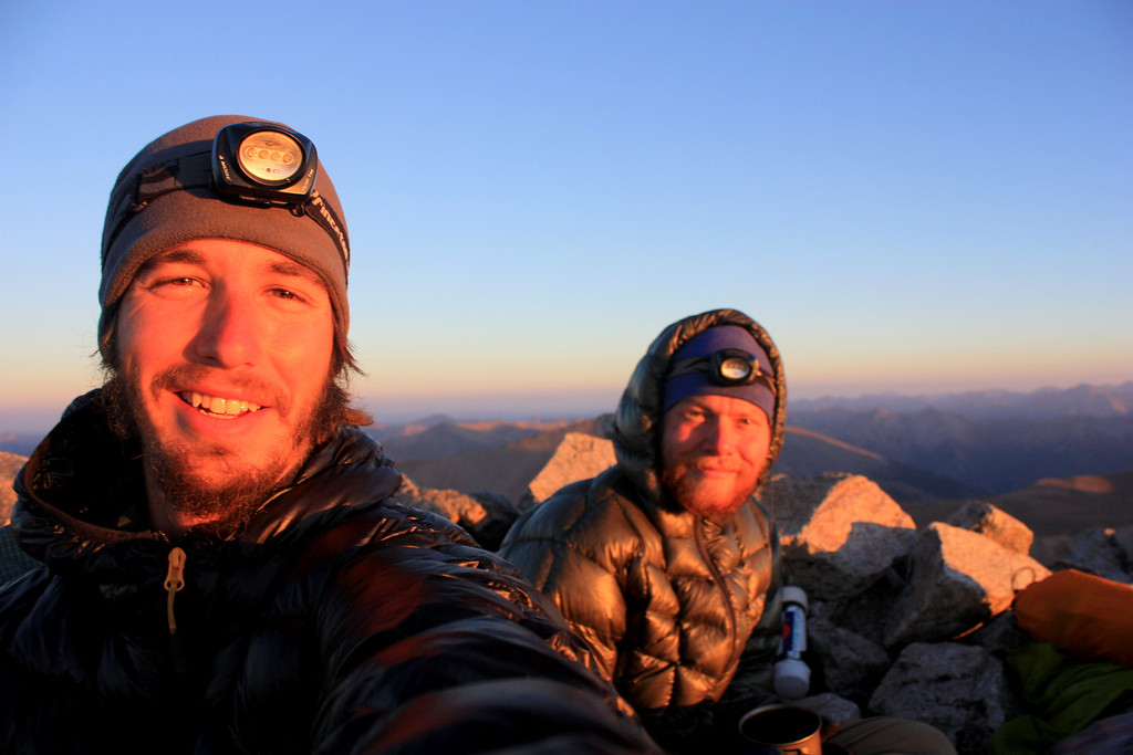. Luke DeMuth, left, and Junaid Dawud rest atop Tabeguache Peak in the Sawatch Range in early September. The pair have hiked 1,300 miles and climbed 57 of the state\'s 58 14,000-foot peaks and plan to finish their 70-day mission Sunday on Longs Peak.