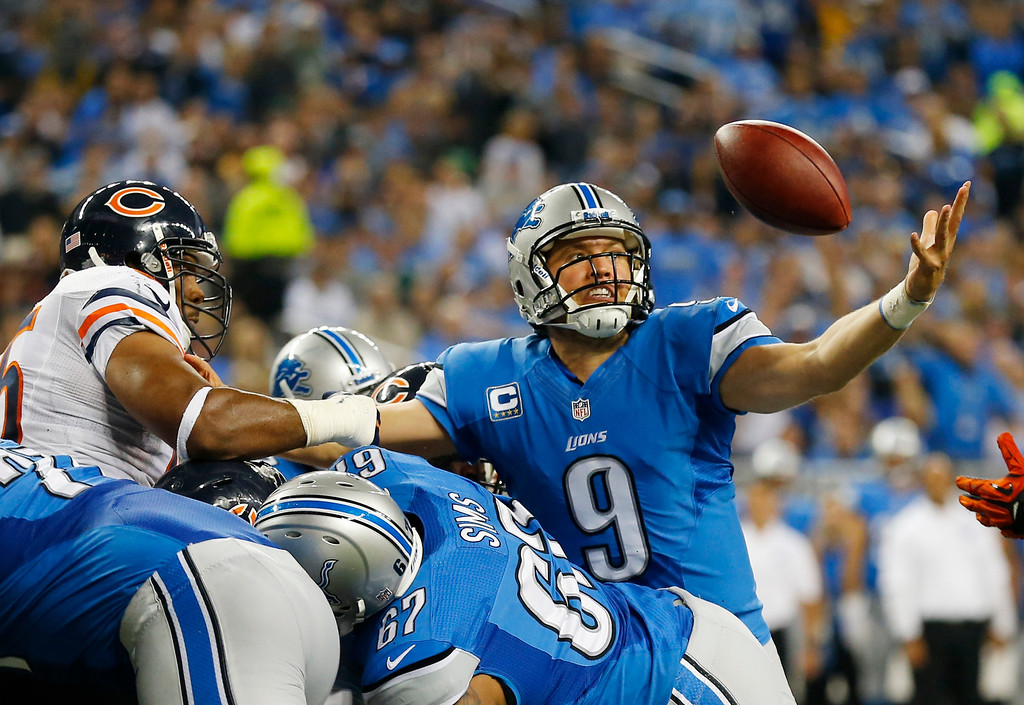. Detroit Lions quarterback Matthew Stafford (9) reaches out to recover his own fumble, and score as he crossed the goal line during the second quarter of an NFL football game against the Chicago Bears at Ford Field in Detroit, Sunday, Sept. 29, 2013. (AP Photo/Paul Sancya)