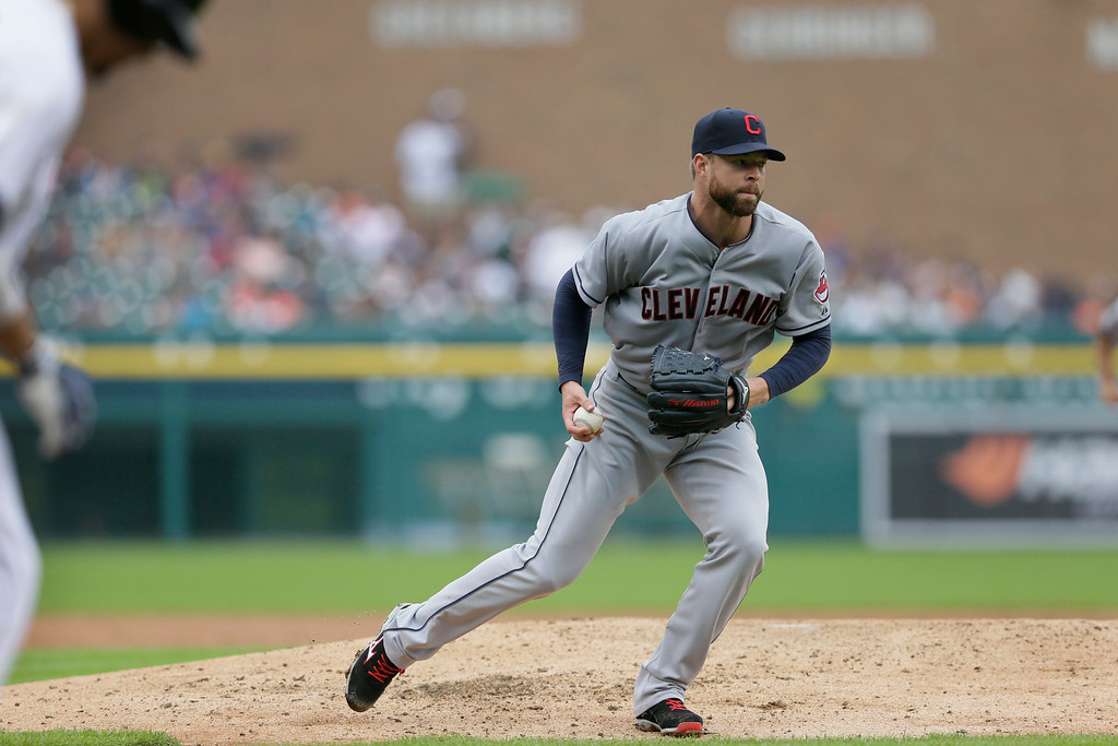 . Cleveland Indians starting pitcher Corey Kluber prepares to throw out Detroit Tigers designated hitter Victor Martinez who hit the ball back to Kluber during the sixth inning in the first baseball game of a doubleheader, Saturday, July 19, 2014 in Detroit. (AP Photo/Carlos Osorio)