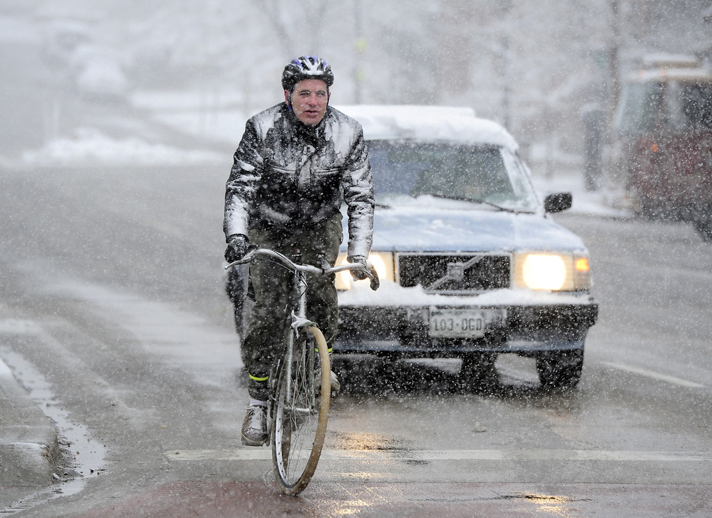 . Dan Hopkins, rides his way to work  during the Wednesday morning snow in Boulder, Colorado on May 1, 2013. (AP Photo/The Daily Camera, Paul Aiken)