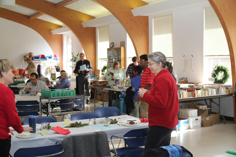 Kathy helps with clean-up and people are still enjoying the book sale.