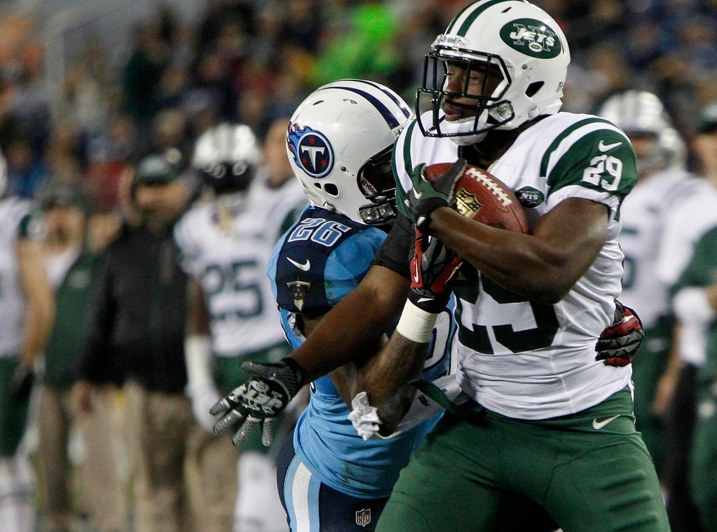 . Tennessee Titans\' safety Jordan Babineaux (26) tackles New York Jets\' running back Bilal Powell (29) in the first half of their NFL Monday Night football game in Nashville, Tennessee, December 17, 2012. REUTERS/Harrison McClary (UNITED STATES - Tags: SPORT FOOTBALL)