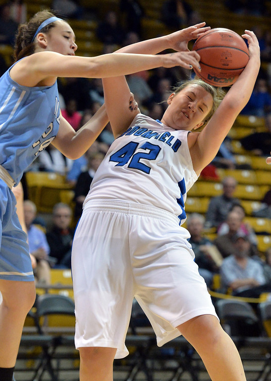 . Broomfield\'s Stacie Hull fights for the ball against Valor Christian\'s Madi Waldon during the final four 4A state game at Coors Event Center. (David R. Jennings/Broomfield Enterprise)