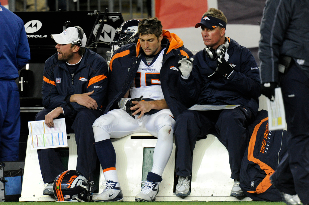 . Denver Broncos quarterback Tim Tebow (15,)  Offensive coordinator Mike McCoy and Adam Gase sit on the sides lines during the 4th quarter as the Broncos lost 45-10. Denver Broncos vs New England Patriots AFC Division Playoff game.  Saturday January 14, 2012 at Gillette Stadium.  John Leyba, The Denver Post