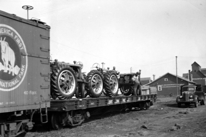 ARE003.  Tractors on railcar – 1936‡.jpg