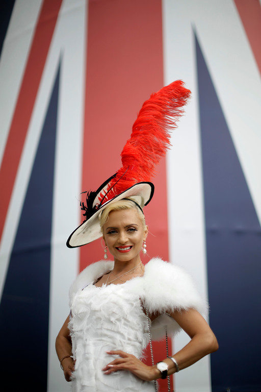 . Lana Holloway, from London, poses for photographers on the first day of the Royal Ascot horse race meeting in Ascot, England, Tuesday, June 19, 2018. (AP Photo/Tim Ireland)