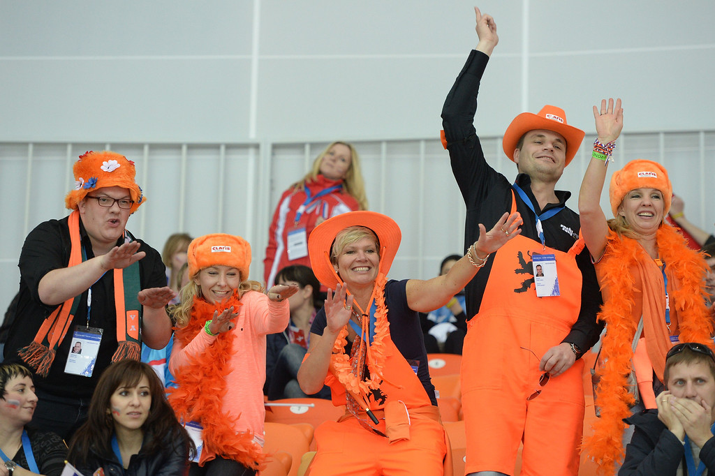 . Dutch fans cheer during the Men\'s Speed Skating 1500 m at the Adler Arena during the Sochi Winter Olympics on February 15, 2014.   JUNG YEON-JE/AFP/Getty Images