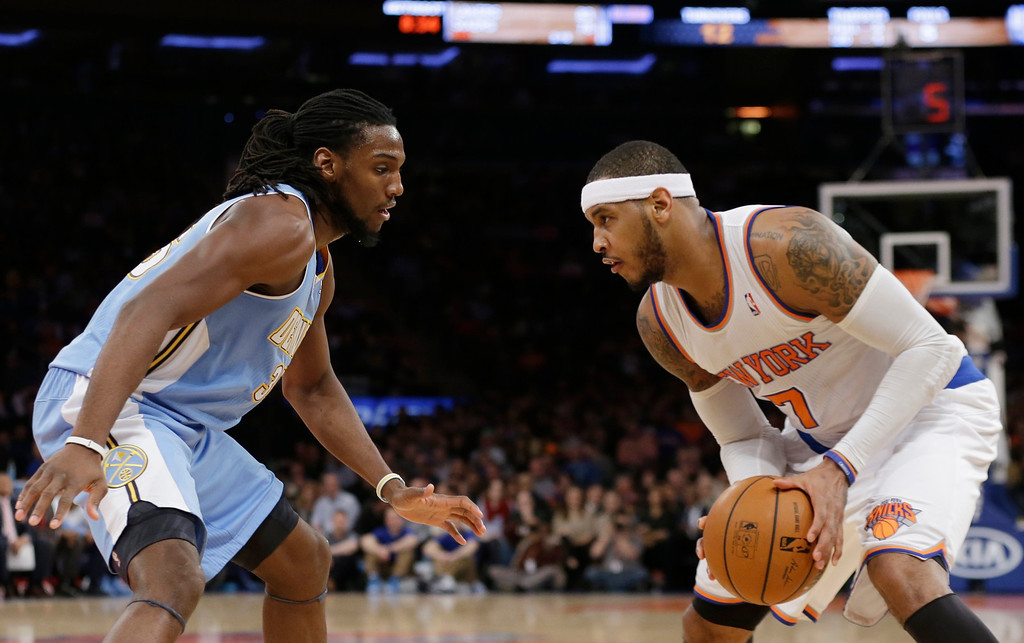 . Denver Nuggets\' Kenneth Faried (35) defends New York Knicks\' Carmelo Anthony (7) during the first half of an NBA basketball game Friday, Feb. 7, 2014, in New York. (AP Photo/Frank Franklin II)