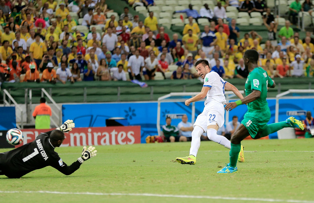 . Greece\'s Andreas Samaris fires a shot past Ivory Coast\'s goalkeeper Boubacar Barry to score his side\'s first goal during the group C World Cup soccer match between Greece and Ivory Coast at the Arena Castelao in Fortaleza, Brazil, Tuesday, June 24, 2014. (AP Photo/Bernat Armangue)