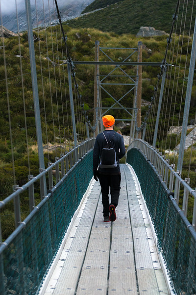 Clint walking across bridge-1.jpg