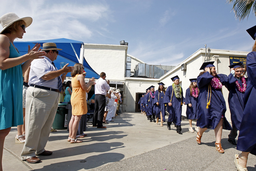 . The Notre Dame High School graduation class walk past family and friends on Saturday, June 01, 2013 in Sherman Oaks, CA.  Photo by Michael Yanow