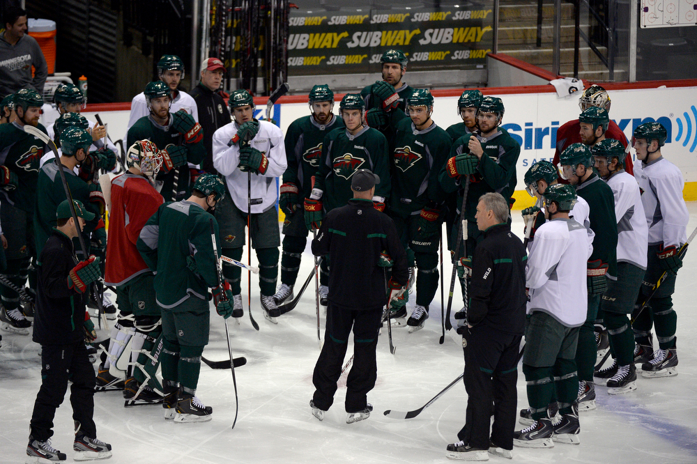 . Minnesota Wild head coach Mike Yeo stalks to the team prod to their practice April 23, 2014 at Xcel Energy Center. (Photo by John Leyba/The Denver Post)
