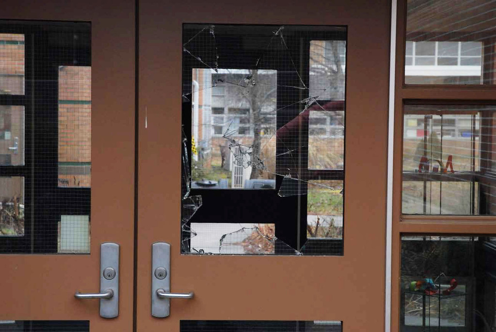 . In this handout crime scene evidence photo provided by the Connecticut State Police, shows a damaged door of the Sandy Hook Elementary School following the December 14, 2012 shooting rampage, taken on an unspecified date in Newtown, Connecticut.  (Photo by Connecticut State Police via Getty Images)
