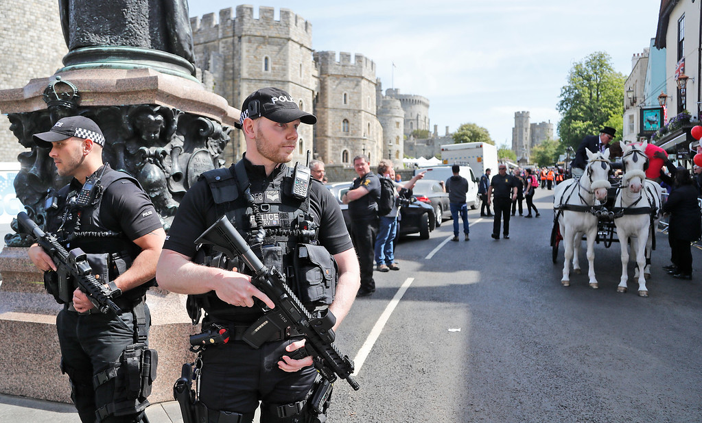 . Armed police patrols the streets in Windsor, Friday, May 18, 2018. Preparations are being made in the town ahead of the wedding of Britain\'s Prince Harry and Meghan Markle that will take place in Windsor on Saturday May 19.(AP Photo/Frank Augstein)