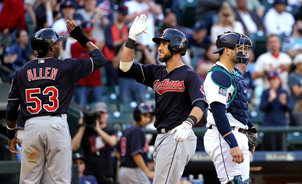 . Cleveland Indians\' Yan Gomes, center, is greeted at home by Greg Allen (53) on his three-run home run as Seattle Mariners catcher Mike Zunino looks away in the ninth inning of a baseball game Saturday, Sept. 23, 2017, in Seattle. (AP Photo/Elaine Thompson)