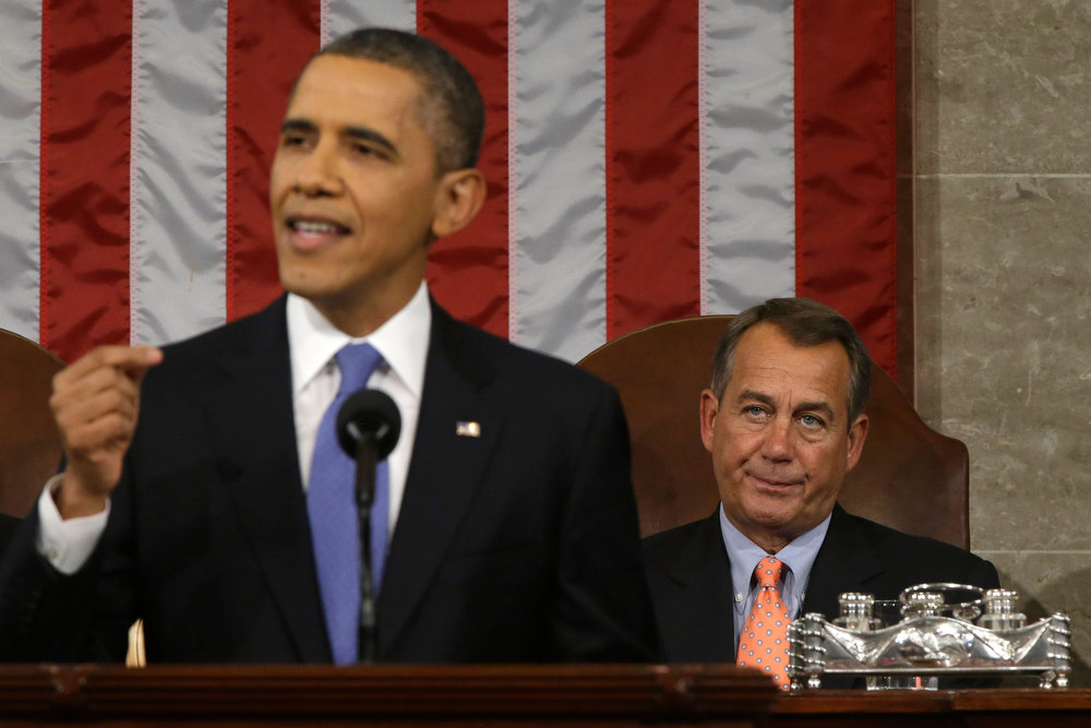 Description of . House Speaker John Boehner (R-OH) (R) listens as U.S. President Barack Obama gives his State of the Union address during a joint session of Congress at the U.S. Capitol February 12, 2013 in Washington, DC. Facing a divided Congress, Obama focused his speech on new initiatives designed to stimulate the U.S. economy. (Photo by Charles Dharapak-Pool/Getty Images)