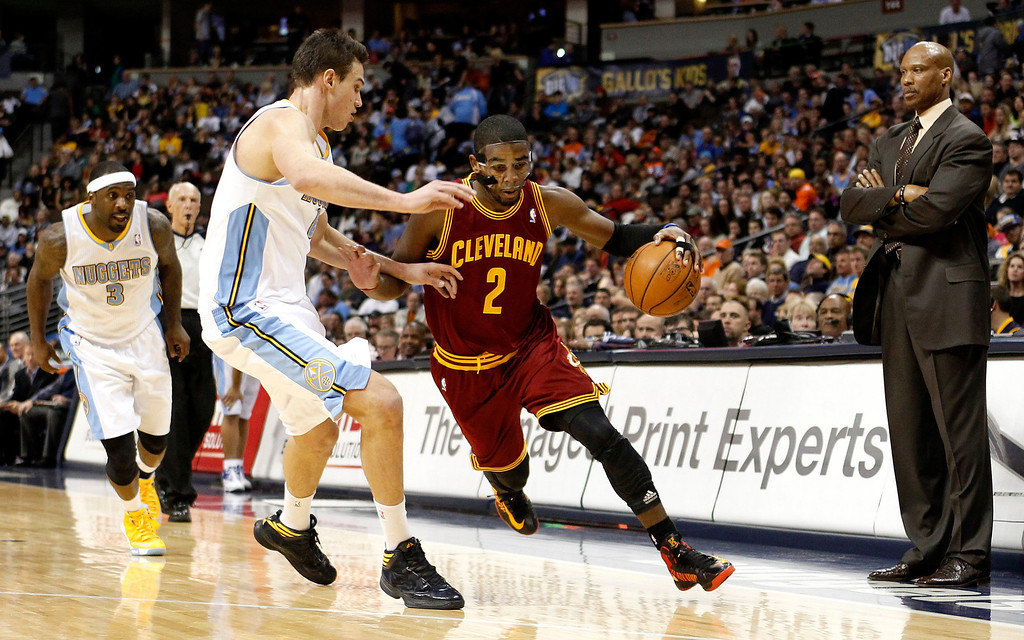 . Kyrie Irving #2 of the Cleveland Cavaliers drives against Danilo Gallinari #8 of the Denver Nuggets at Pepsi Center on January 11, 2013 in Denver, Colorado. (Photo by Chris Chambers/Getty Images)