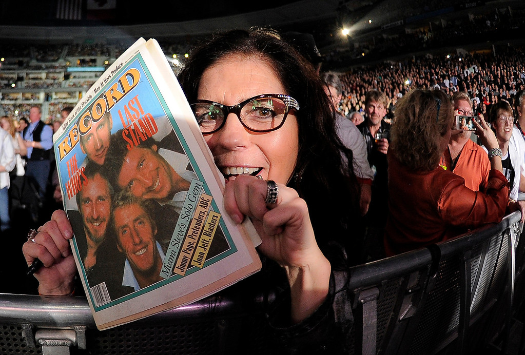 . DENVER, CO. - FEBRUARY 12: A fan holds up an old Record magazine with The Who on the cover. The Who performs during their Quadrophenia tour stop February 12, 2013 at Pepsi Center.  (Photo By John Leyba/The Denver Post)