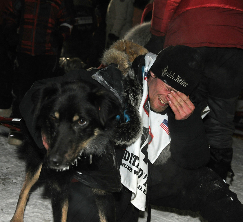 . Dallas Seavey holds his lead dog Beatle after winning the 2014 Iditarod Trail Sled Dog Race in Nome, Alaska, Tuesday, March 11, 2014.  (AP Photo/The Anchorage Daily News, Bob Hallinen)