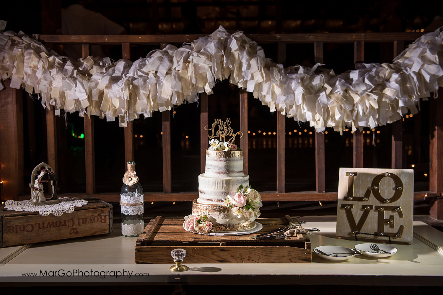 wedding cake decorated with roses at Taber Ranch Vineyards