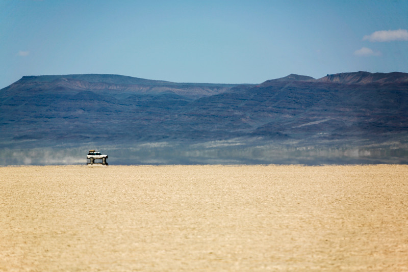 View of car near steens mountains at Alvord Desert - USA - Oregon