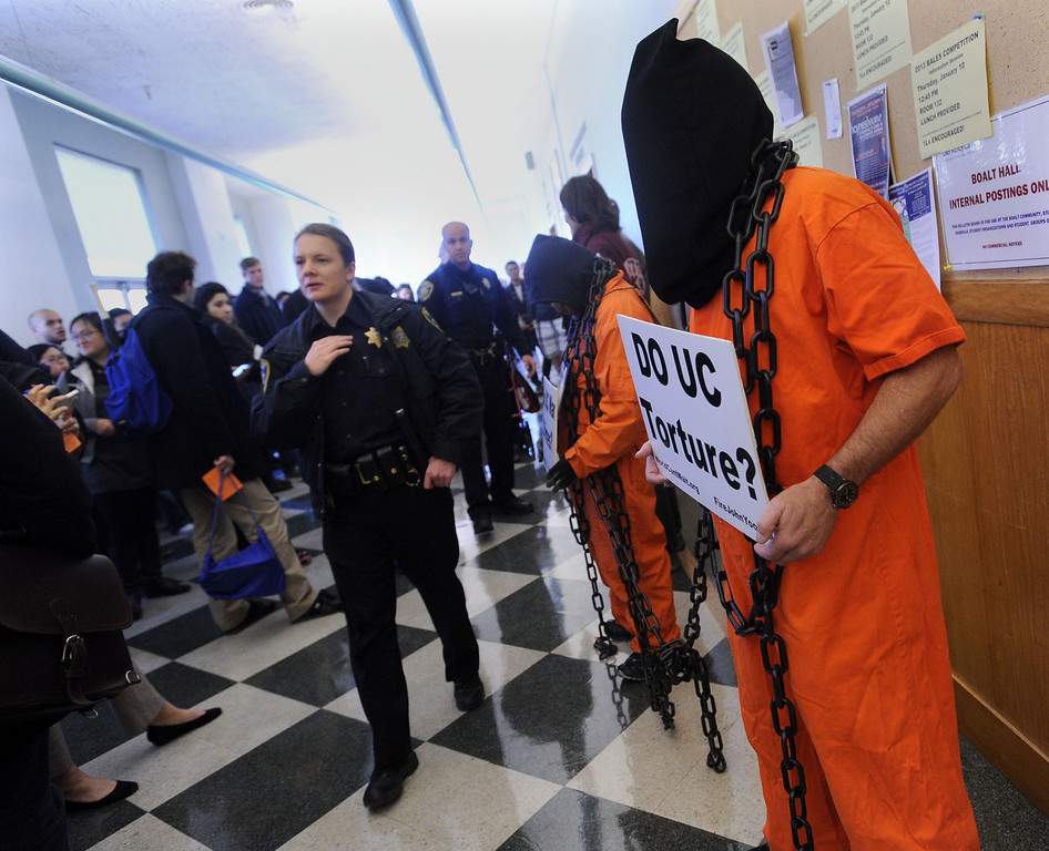. Mike Baldwin, of Hayward and World Can\'t Wait, stands in protest outside an event involving UC Berkeley faculty member John Yoo held in Boalt Hall on the UC Berkeley campus in Berkeley, Calif. on Thursday, Jan. 10, 2013. Some feel that Yoo played a role in the torture program at the United States prison at Guantanamo under the Bush Administration and should not be employed by the university. The event was a debate on Obama Care with University of Saint Thomas School of Law Professor Michael Paulsen sponsored by the Berkeley Federalist Society. (Dan Honda/Staff)