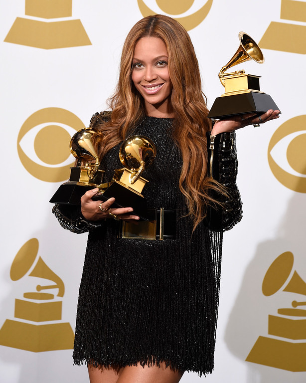 . Beyonce poses in the press room with the awards for best R&B performance for �Drunk in Love�, best surround sound album for �Beyonce�, and best R&B song for �Drunk in Love� at the 57th annual Grammy Awards at the Staples Center on Sunday, Feb. 8, 2015, in Los Angeles. (Photo by Chris Pizzello/Invision/AP)
