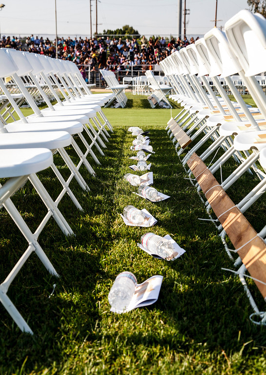 . Water and programs await the arrival of the 2013 graduates to arrive, at John H Francis Polytechnic High School, Sun Valley, Calif., June 7, 2013. Photo: Lynn Levitt.