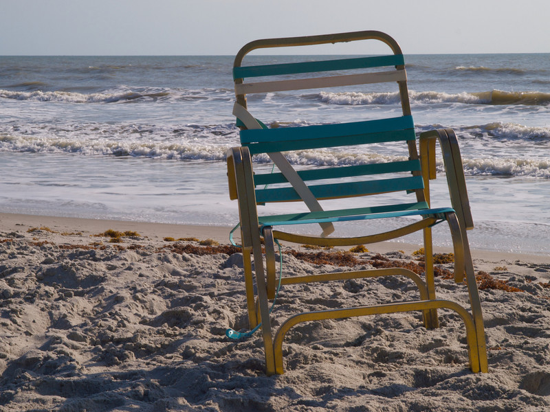 Bronze chair. Cocoa Beach, Florida