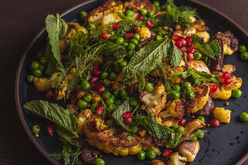 cauliflower with mint, peas, and pomegranite