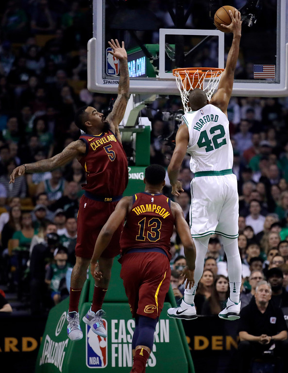 . Boston Celtics forward Al Horford (42) soars to dunk against Cleveland Cavaliers guard JR Smith (5) and center Tristan Thompson (13) during the first half in Game 2 of the NBA basketball Eastern Conference finals Tuesday, May 15, 2018, in Boston. (AP Photo/Charles Krupa)